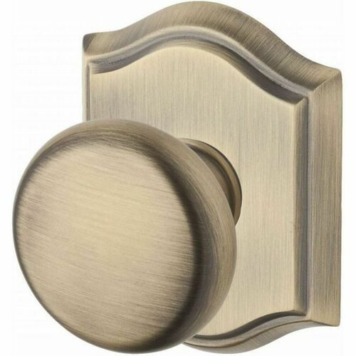 Baldwin ENROUTAR049 Entry Round Knob and Traditional Arch Rose with 6AL Latch and Dual Strike Matte Brass and Black Finish